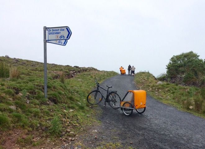 It can be a cold, wet uphill push cycling the Great Western Greenway in Ireland with kids, but it's still worthwhile says one suitcases&strollers mum. Find out why on our website http://www.suitcasesandstrollers.com/interviews/view/cycling-in-ireland-with-kids?l=all #GoogleUs #suitcasesandstrollers #travel #travelwithkids #familytravel #familytraveltips #traveltips #uphill #pushbike #theclimb #Ireland #cycletour #biketour