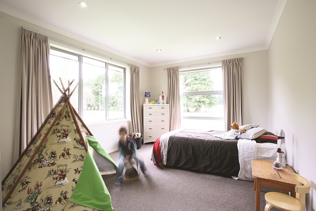 Spacious bedrooms create room for a growing family...and they're large enough to house a teepee.
