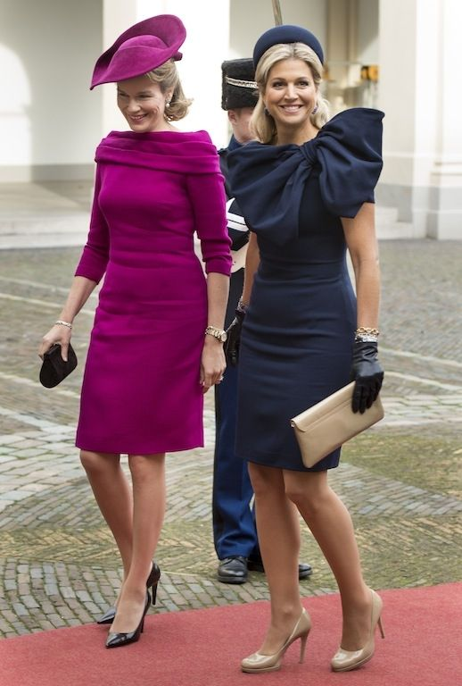 Máxima wearing a dark blue Jan Taminiau dress with a big bow