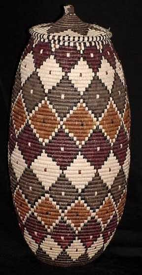 "Museum Art Quality Zulu Basket - This basket is 31"" around at its widest point and 21"" tall. Certificate of Authenticity with Weaver's Name."