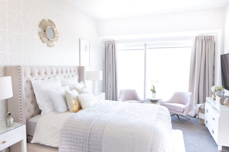 A light, neutral color palette and layering of lush textures made this bedroom chic, cozy, and timelessly stylish.