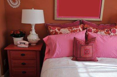 Traditional furniture goes well with whimsical or eclectic bedrooms, such as this pink girl's bedroom. This traditional side table blends in well with the fun decorative pillows, wall color, lamp, and other cute accessories. If you are planning to re-do a child's bedroom, normally your traditional bedroom furniture will be perfect match for any playful theme.