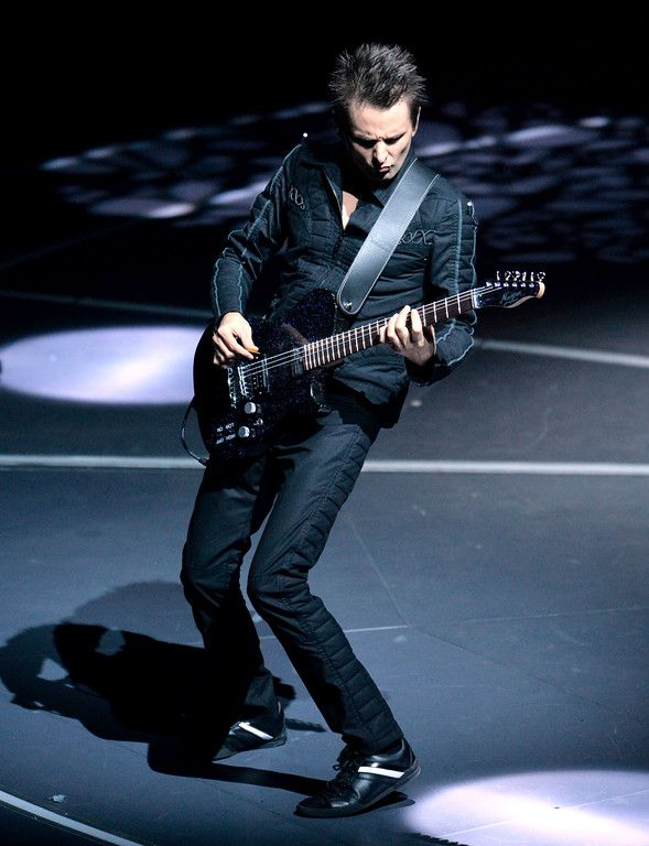 . Matt Bellamy, with the band Muse, plays lead guitar during the band�s  �Drones World Tour� concert at Oracle Arena in Oakland, Calif., on Tuesday, Dec. 15, 2015. (Doug Duran/Bay Area News Group):