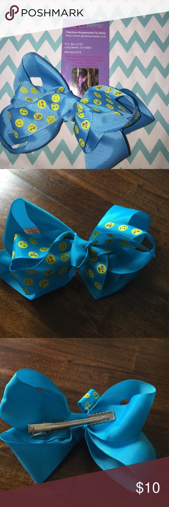 Baby Girl Large Emoji Hair Bows Bright blue hair bow. Metal clip. Emojis on inner bow. Gold bow has no emojis. Ashlyn and Audrey Accessories Hair Accessories