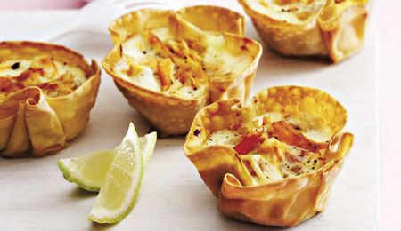 Fish bobotie in poppadum cups - Ina Paarman shows us a classy way to present one of our heritage dishes. The trick is to half-bake the poppadums in muffin pans before adding the fish filling and topping. #MiniFood