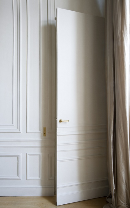 Door disguised with beautiful millwork - Andrew Skurman Architects