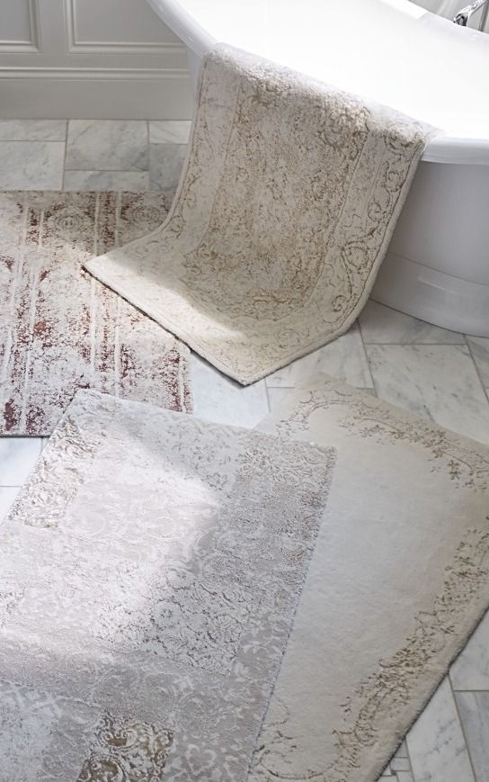 Taking a cue from vintage-wash area rugs, the Madalyon Bath Rug features a faded antique-inspired pattern enhanced by muted color. Woven of supremely soft Turkish cotton and viscose with a skid-resistant back, it's the perfect way to continue a favorite decor theme into the bath.