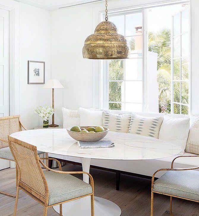 Beautiful breakfast nook with a Saarinen table