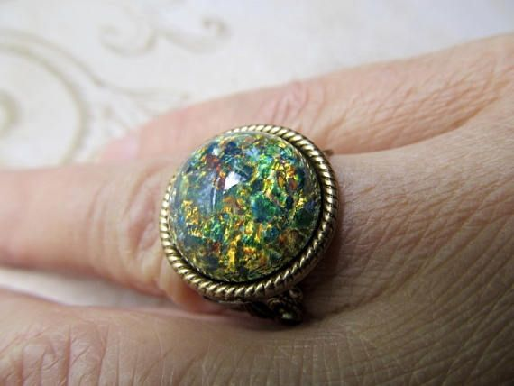 Black Opal Ring Fire Opal Ring Game of Thrones Jewelry Blue Opal Ring Art Deco Ring Art Nouveau Ring 1920s Ring Filigree Ring- Blue Eyes  I used a vibrant vintage dark blue fire opal that also has green, gold, and copper in it. It sparkles and flashes gold and copper iridescence with every move. Looking for a gift? The art nouveau band is brass filigree and is adjustable, it will fit on any finger you choose, so you dont have to worry about a size. For something special its Blue Eyes! *The…