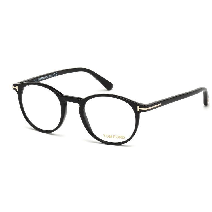 Tom Ford FT5294 001. Occhiale da vista Tom Ford ideale sia per l'uomo che per la donna. Montatura interamente in celluloide di colore nero. Frontale con forma tondeggiante e particolare ponte a chiave che richiama lo stile vintage.