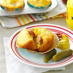 "Cheddar Corn Dog Muffins Recipe -I wanted to riff on hot dogs, so I made corn dog muffins. I added jalapenos to this ""kid friendly"" recipe and won my husband over, too. —Becky Tarala, Palm Coast, Florida"