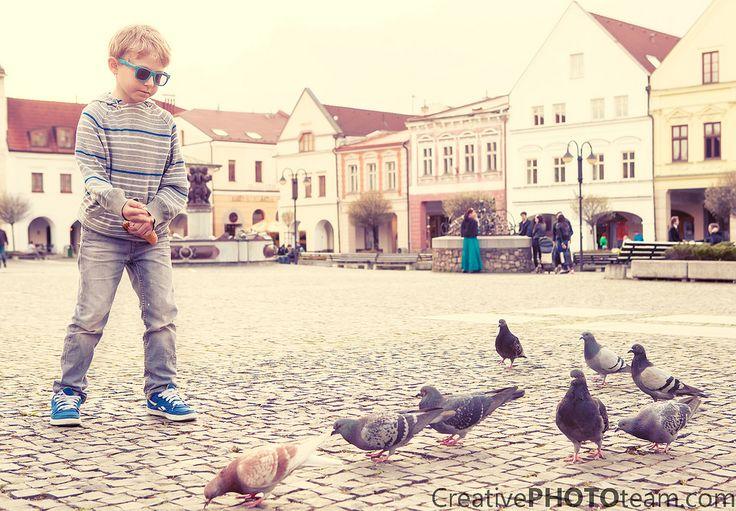 https://flic.kr/p/EMWdjY | Boy feeding doves on the old city square | Boy feeding doves  by www.creativephototeam.com #Zilina #dove #people #kids #animals #travel #slovakia