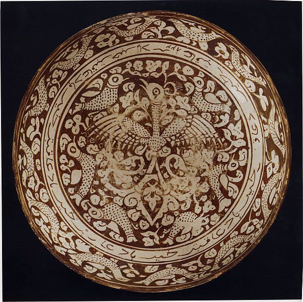 Bowl with Repeating Persian Inscription Wishing for Good Fortune Object Name: Bowl Date: dated A.H. 822/ A.D. 1419–20 Geography: Afghanistan or Iran Culture: Islamic Medium: Stonepaste; luster-painted on opaque white glaze Dimensions: Diam. 11 1/4 in. (28.6 cm) H. 4 7/8 in. (12.4 cm) Classification: Ceramics Credit Line: Purchase, Louis E. and Theresa S. Seley Purchase Fund for Islamic Art, and funds from various donors, 2005 Accession Number: 2005.1
