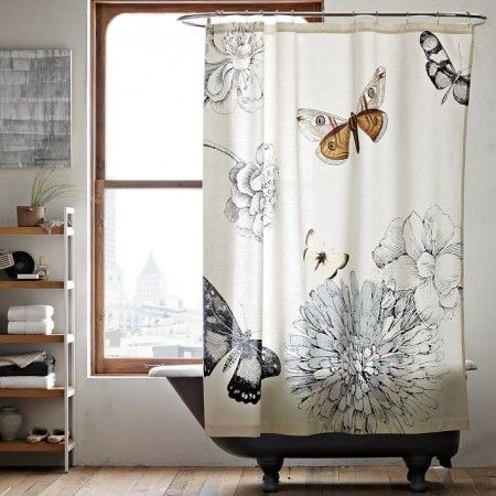 bathroom with claw foot tub and west elm butterfly shower curtain