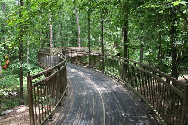 The Millsap Canopy Bridge is two-stories above the forest floor & spanning 120 feet, the winding treetop bridge is a breathtaking experiences. Its gently curved walkway travels through a woodland landscape of pools, cascades & verdant plantings nestled in Singing Springs Gorge inside Garvan Woodland Gardens in Hot Springs, http://www.garvangardens.org/ #Arkansas #bridge #garden #forest #weddings