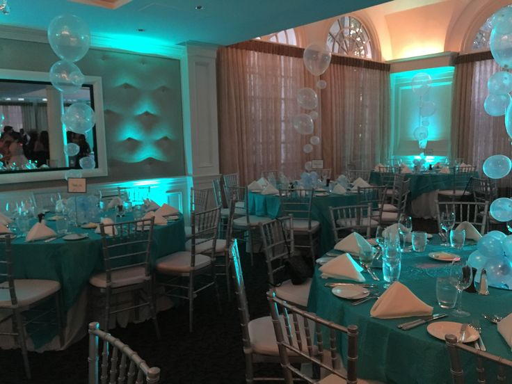 Blue uplighting and bubble strand centerpieces for an Under The Sea theme