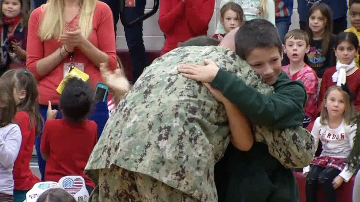 Navy dad pulls off homecoming surprise for sons at school's Veterans Day event