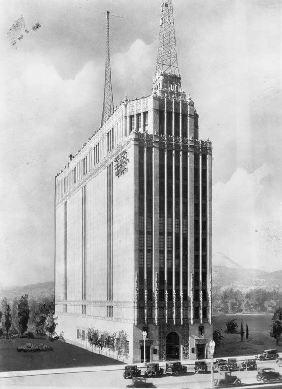 (1928)* - Frontal view of the Hollywood Storage Co. Building, located at 1025 N. Highland Ave. Located at Highland Avenue and Santa Monica Boulevard, the building was also home of the Evening Herald radio station, KMTR.