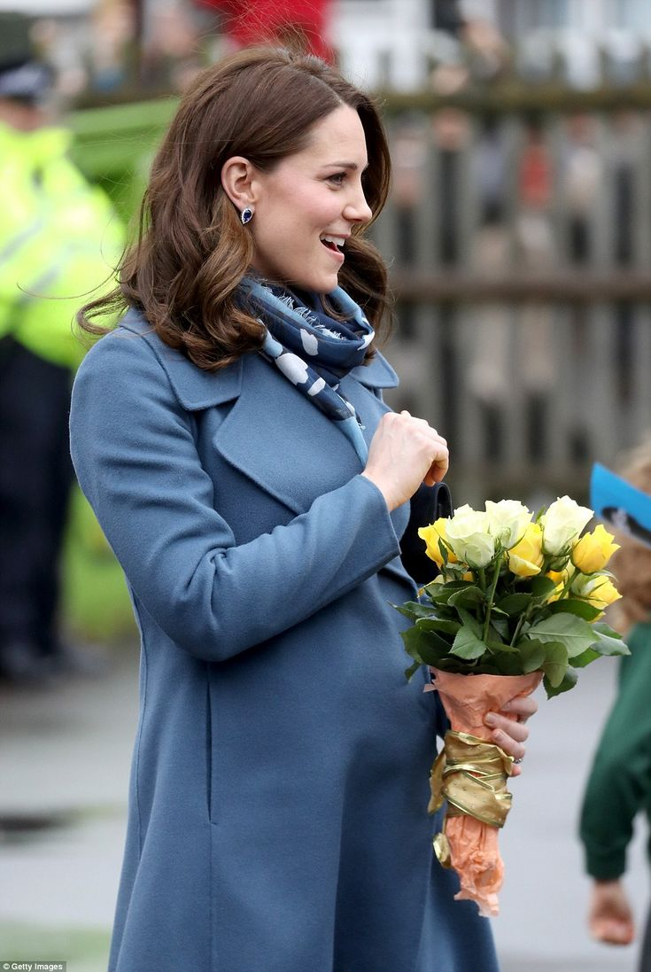The Duchess showed off a hint of her very neat baby bump underneath her smart Sportmax coa...