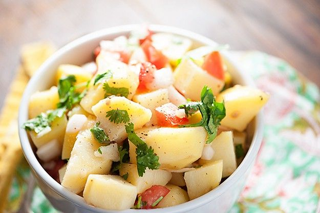 There is no mayo in this bright and refreshing potato salad recipe! It's light, healthy, and perfect for a hot summer day!