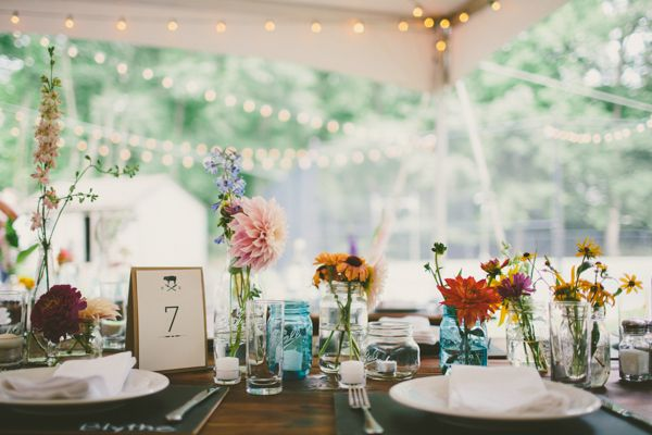 Mason jars and wildflowers look simple and gorgeous for a rustic reception | http://www.weddingpartyapp.com/blog/2014/10/29/boho-farm-table-wedding-katch-silva/