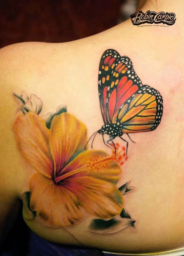 3D butterfly with flower tattoo on back shoulder by Robin Carpio                                                                                                                                                     More