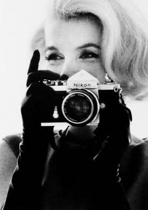 Marilyn Monroe with a camera, photographed by Bert Stern.