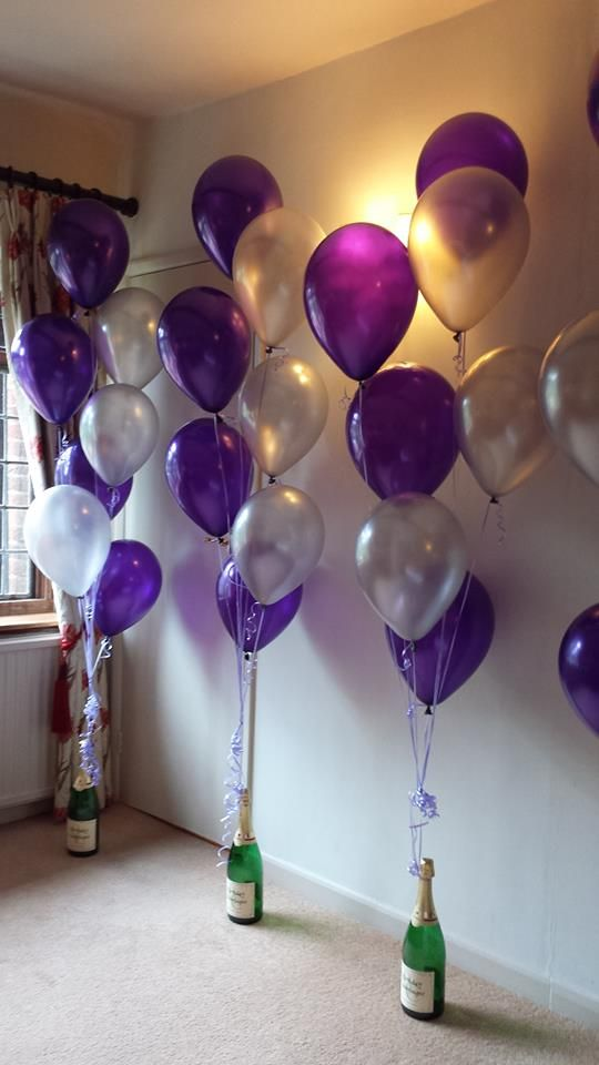 Back to Portfolio Menu 90th Birthday Celebrations at Seckford Hall: Purple Balloons from personalised Champagne bottles: 60th Birthday Dinner: Black and Si