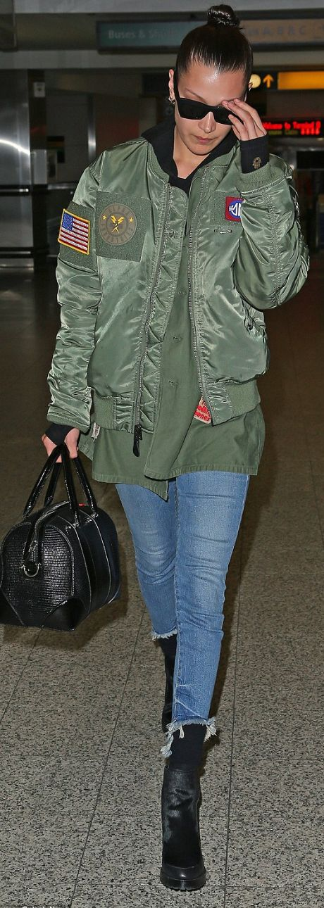 Bella Hadid' in Jacket – Alpha Industries Purse – Givenchy Jeans – True Religion
