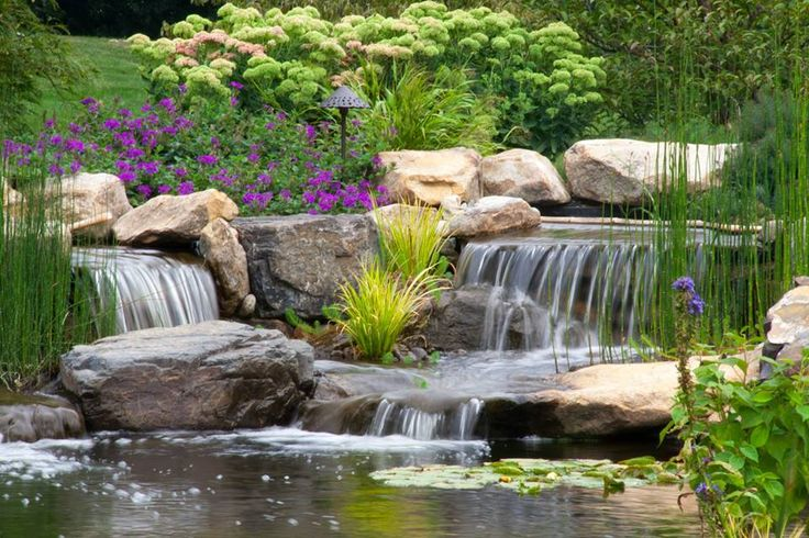 Waterfall created by Signature Pond & Patio in Wernersville, PA. #WaterfallWednesday