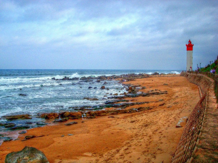 Umhlanga Rocks, Durban. I remember walking past the lighthouse and watching the ocean beat against the rocks.