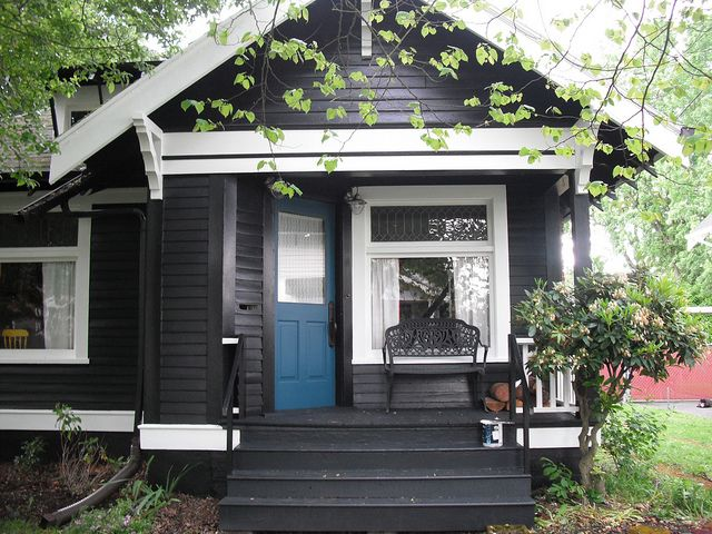 Black with white trim and bright blue door where the heart is pinterest white trim - Black house with white trim ...