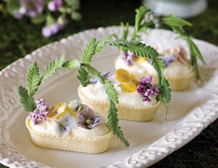 Here's the recipes! These pretty Cream-Filled White Chocolate Baskets are filled with whipped cream flavored with vanilla and orange zest.