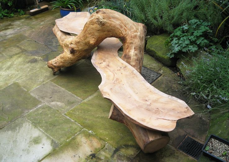 Sculptural seat consisting of a oak board fitting perfectly with a piece of twisted oak tree. We take on commissions for unique seating, seating areas and sculptural pieces for your home, school or business.