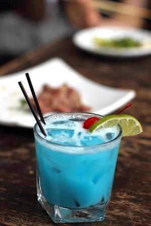 Happy Colada. Blue Curacao, Coconut Rum, & Pineapple Juice