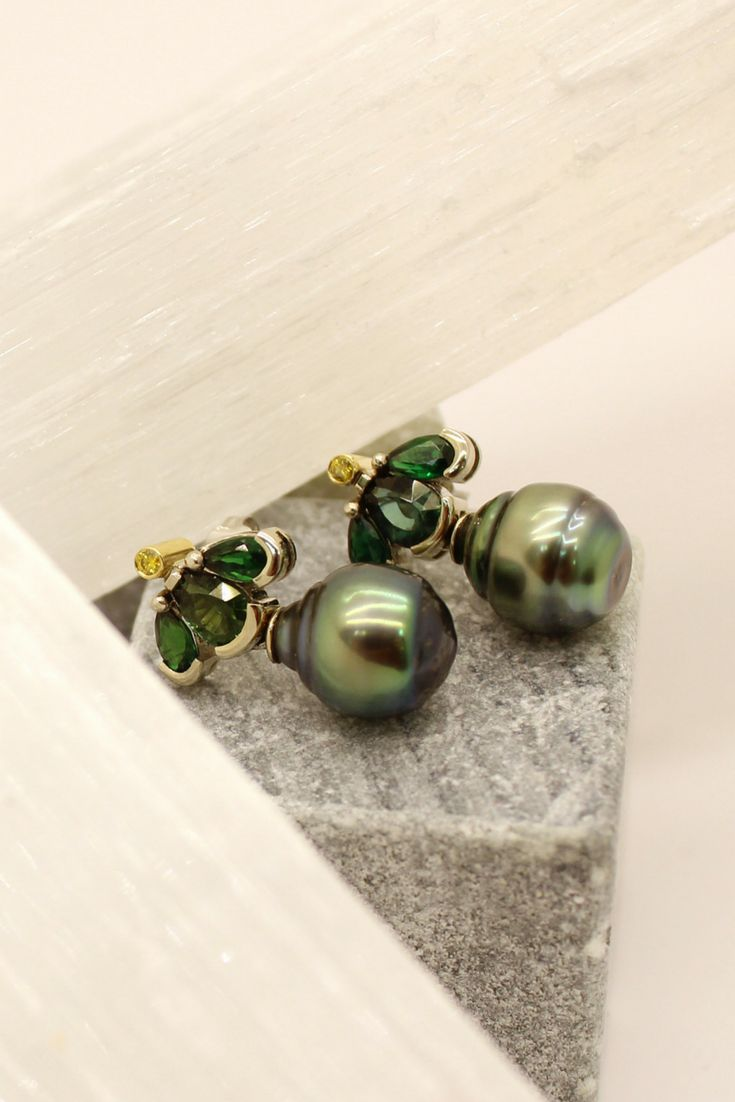Unique pearl and emerald earrings custom crafted for a special client.