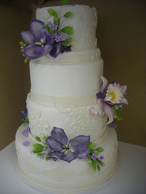 Ivory fondant and purple sugar flowers by A Sweet Design
