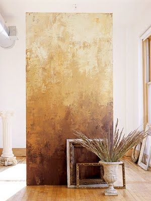 have a strip of texture and color that is a canvas apart from the wall- use a piece of dry wall perhaps?