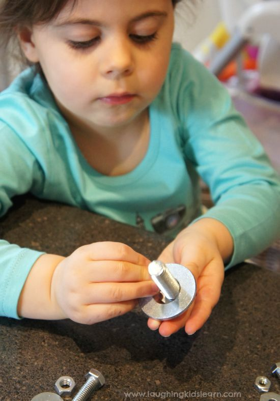 Developing fine motor skills with nuts and bolts