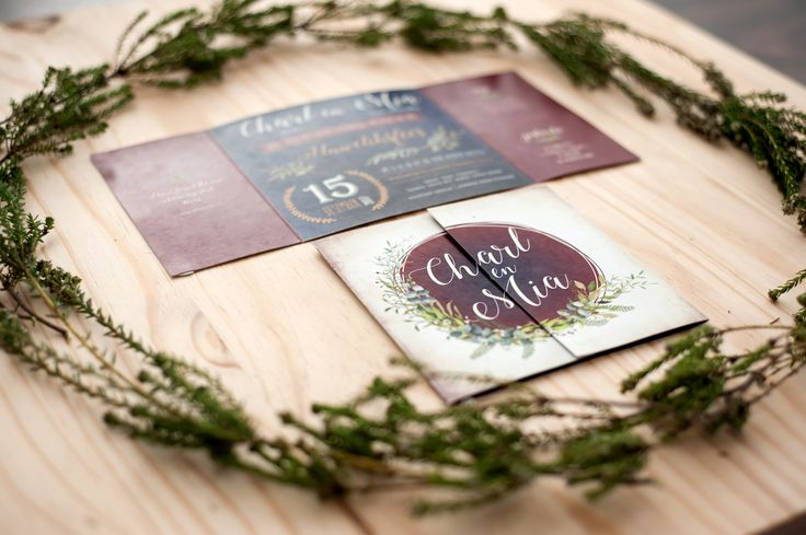 Dramatic dark hues in a forest themed wedding invitation