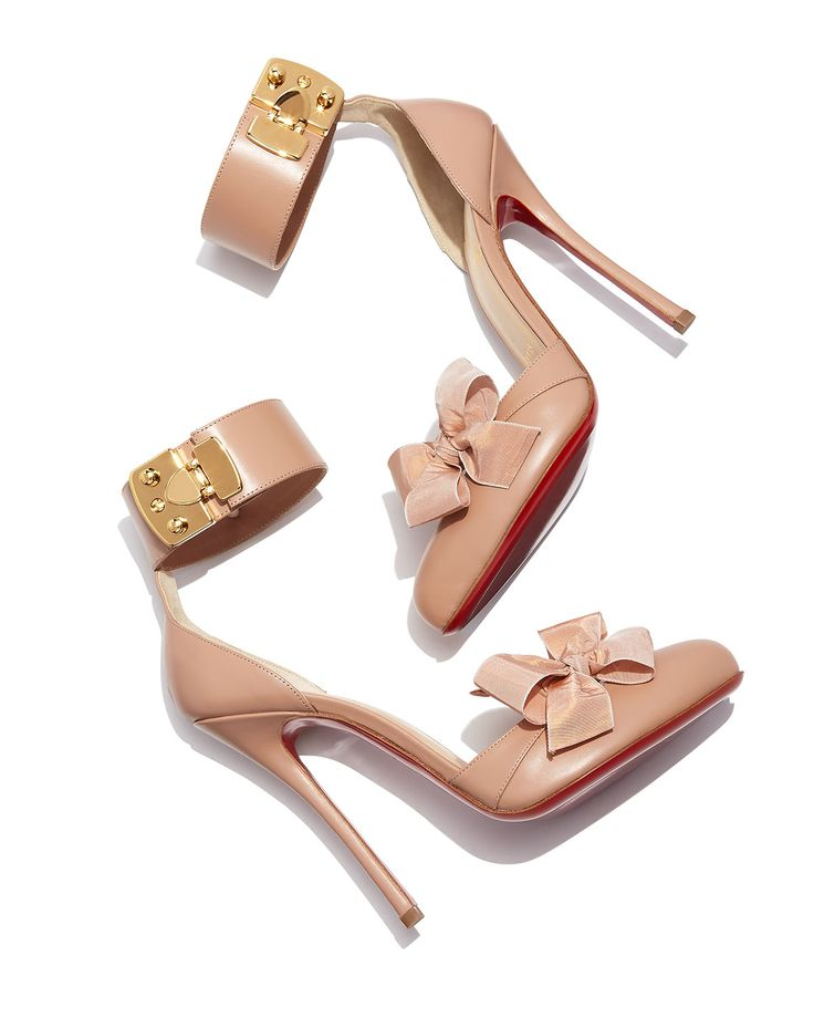 Exclusivelly ours: Christian Louboutin Fetish Red Sole d'Orsay Pump in nude with golden hardware details.