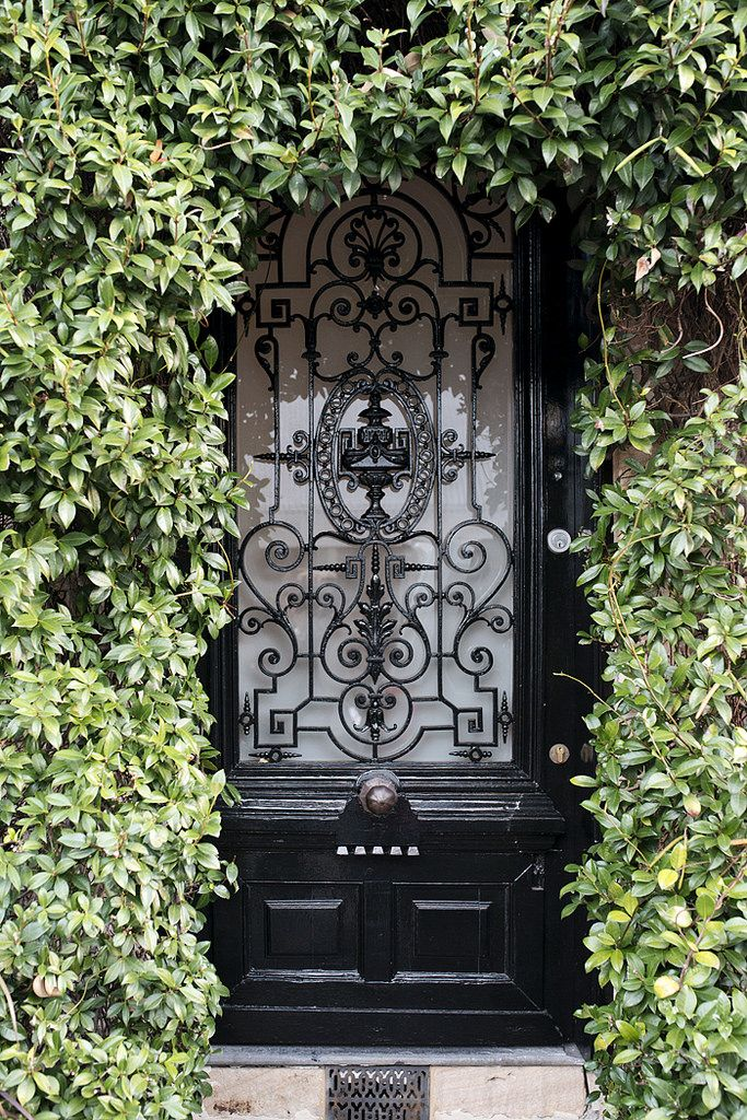 This Sydney front door sure packs a punch! The swirling ironwork on the black door & 132 best Statement Doors FurnishMyWay images on Pinterest ...
