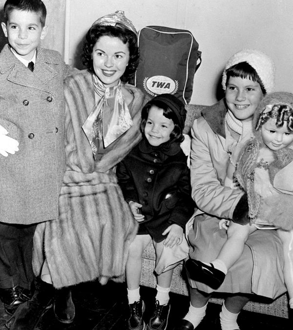 Thanksgiving 1959 Shirley Temple with her children, Charles, Lori, and Linda Susan, who is holding a Shirley Temple Playpal doll. They all rode in the Macy's Thanksgiving Day Parade that morning, including the doll!