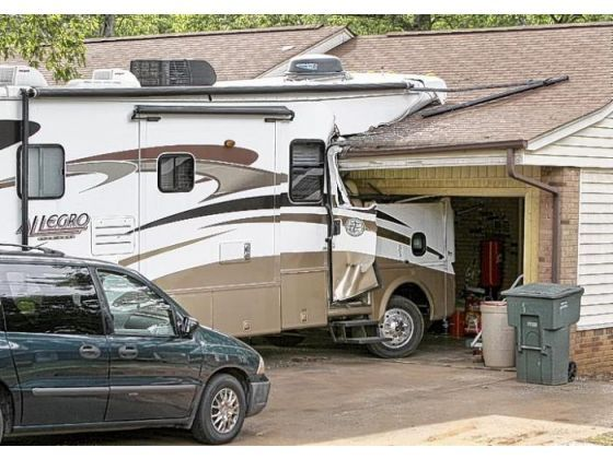 You might need a bigger garage oops time to get a new for Rv garage door