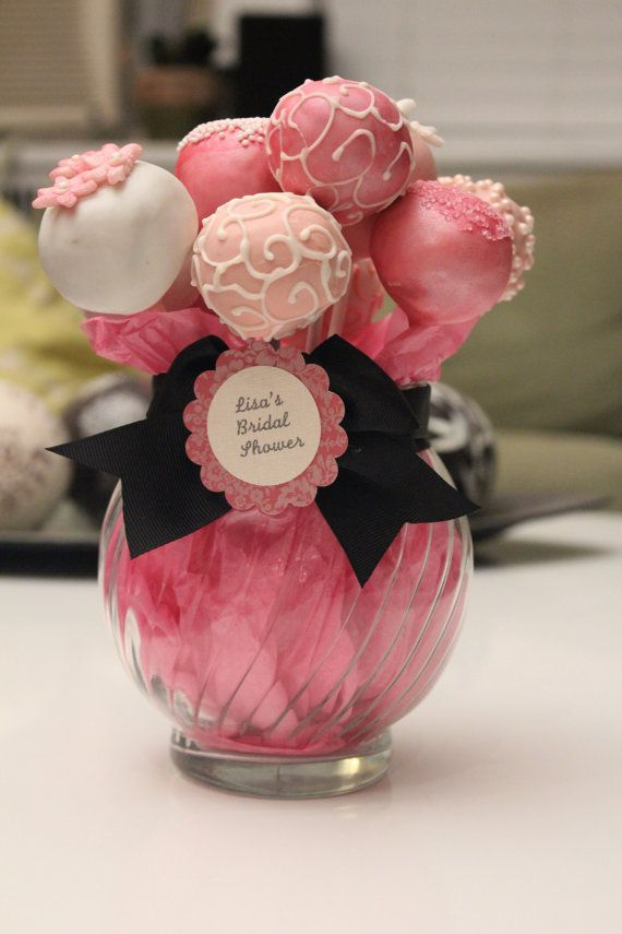 cake pop centerpieces, less pressure deciding what you're going to do with them after the reception when they're edible
