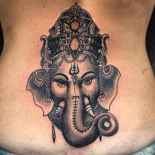 Ganesha, GaneshTattoos - Ganesha, the zoomorphic deity with the head of an elephant and the body of a human, is one of the most popular of India's many deities.