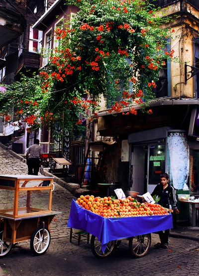 Boy selling peaches - Istanbul, Turkey