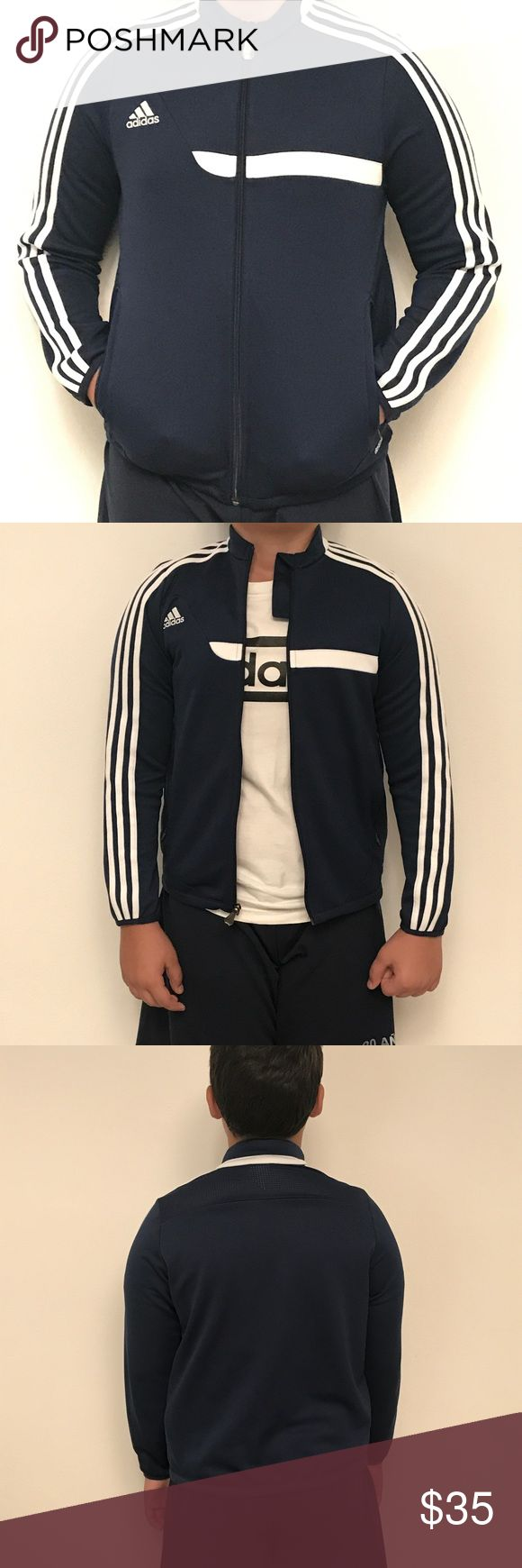 ADIDAS BOYS TRACKSUIT TOP JACKET NAVY BLUE BOYS ADIDAS TRACKSUIT TOP JACKET SIZE YM NAVY BLUE This jacket is pre-owned. It's a BOYS size. Fits a size 10-12-14 BOYS It has no worn damage. Please see pictures for more details. Jacket is like new. adidas Jackets & Coats