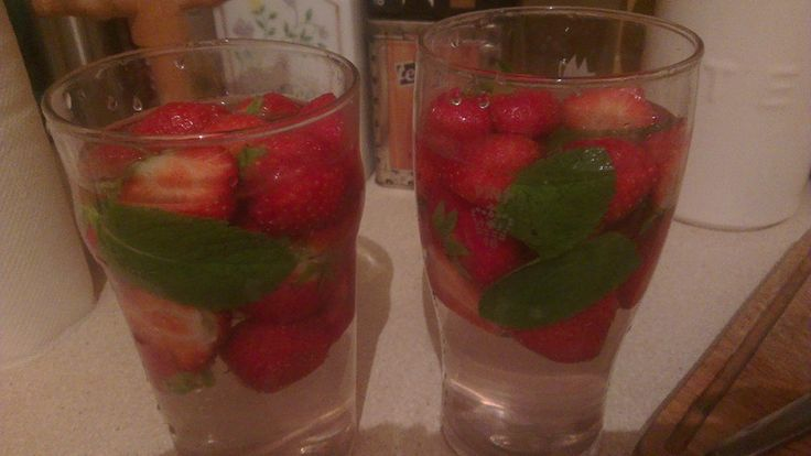 Fruit spa water with strawberries and fresh mint