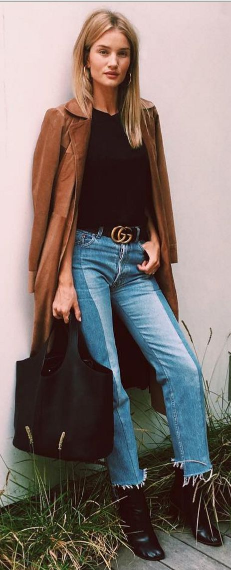 Rosie Huntington-Whiteley: Coat – Reformation  Shoes – Vetements  Belt – Gucci  Purse – Tom Ford  Jeans – Vetements  Earrings – Celine  Ring – Neil Lane
